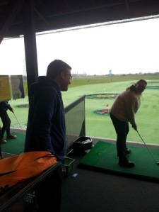 conversation in a TopGolf bay