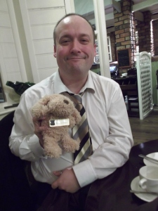 Tim holding a teddy bear