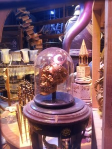 Prop items including jewelled skulls and wands from the Harry Potter films